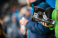Fan Reads a program <br /> Re: Behind the Scenes Photographs at the Liberty Stadium ahead of and during the Premier League match between Swansea City and Bournemouth at the Liberty Stadium, Swansea, Wales, UK. Saturday 25 November 2017