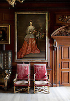 An early 18th century portrait of a young woman hangs by the door of the drawing room