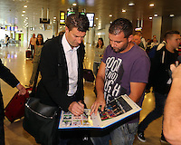 Wednesday 18 September 2013<br /> Pictured: Manager Michael Laudrup signs an autograph for a fan upon his arrival to Valencia Airport.<br /> Re: Swansea City FC players and staff travelling to Spain for their UEFA Europa League game against Valencia.