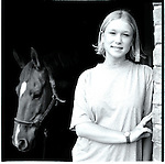 A young woman in Sweden with her horse in Kristianstad, Sweden. Europe before the euro.