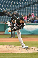 Eric Berger (18) of the Sacramento River Cats delivers a pitch to the plate against the Salt Lake Bees at Smith's Ballpark on April 3, 2014 in Salt Lake City, Utah.  (Stephen Smith/Four Seam Images)