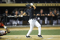 D.J. Poteet (4) of the Wake Forest Demon Deacons follows through on his swing against the Virginia Cavaliers at David F. Couch Ballpark on May 18, 2018 in  Winston-Salem, North Carolina.  The Cavaliers defeated the Demon Deacons 15-3.  (Brian Westerholt/Four Seam Images)