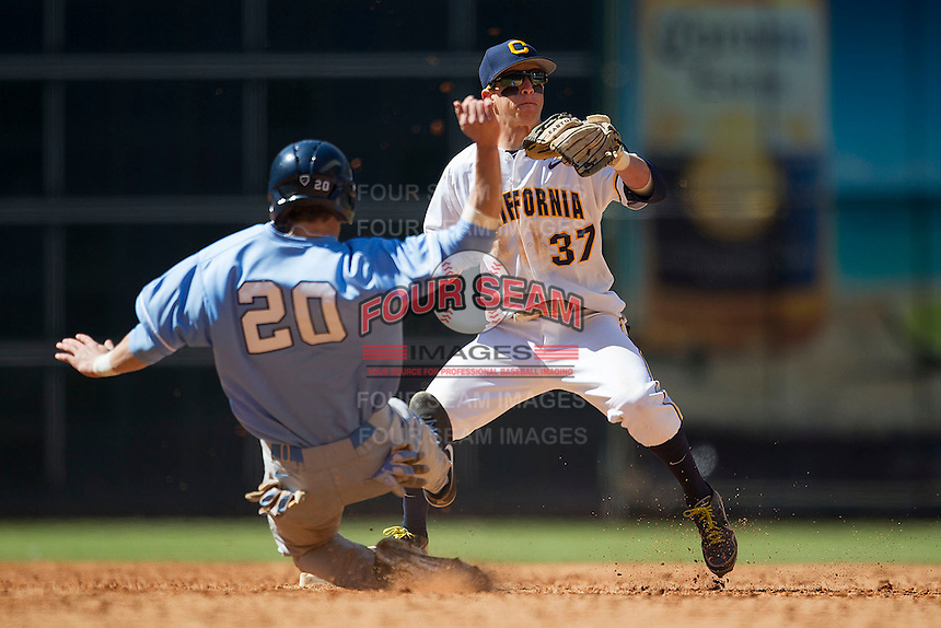 California Golden Bears shortstop Mike Reuvekamp #37 turns a double play as North Carolina Tar Heel baserunner Skye Bolt #20 slides into second base during the NCAA baseball game on March 2nd, 2013 at Minute Maid Park in Houston, Texas. North Carolina defeated Cal 11-5. (Andrew Woolley/Four Seam Images).