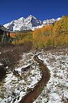 Hiking trail and autumn snow, Maroon Bells Peak, near Aspen, Colorado. John offers autumn photo tours throughout Colorado. .  John leads hiking and photo tours throughout Colorado.