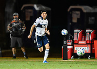 LAKE BUENA VISTA, FL - JULY 26: Cristián Gutiérrez of Vancouver Whitecaps FC dribbles the ball during a game between Vancouver Whitecaps and Sporting Kansas City at ESPN Wide World of Sports on July 26, 2020 in Lake Buena Vista, Florida.