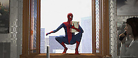 Spiderman appears to pick up the film and deliver it to the theatre.