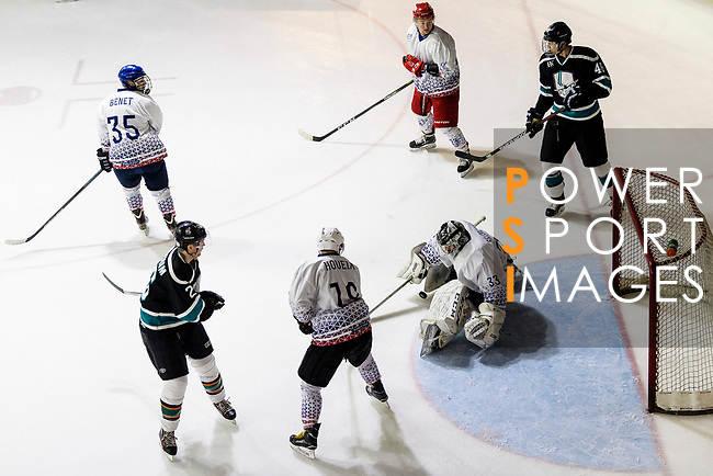 Rodolphe Brunetti of Flying French Goalie (C) makes a save on Charlie Huber of Cathay Flyers (R) during the Mega Ice Hockey 5s match between Flying French and Cathay Flyers on May 03, 2018 in Hong Kong, Hong Kong. Photo by Marcio Rodrigo Machado / Power Sport Images