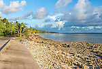 The narrow main road along the atoll in Tuvalu separating the ocean from the lagoon
