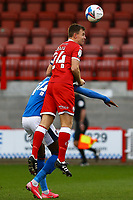 Tony Craig of Crawley Town and Joshua Kayode of Carlisle United during Crawley Town vs Carlisle United, Sky Bet EFL League 2 Football at Broadfield Stadium on 21st November 2020