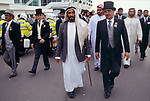 Sheik Zayed bin Sultan al Nahyan President of United Arab Emirates the Derby Horse race with his entourage Epsom Downs. Courtiers body guards and no doubt hangers on. 1980s UK
