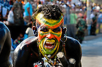 A Colombian man, wearing an Indian make-up, screams during the Carnival in Barranquilla, Colombia, 27 February 2006. The Carnival of Barranquilla is a unique festivity which takes place every year during February or March on the Caribbean coast of Colombia. A colourful mixture of the ancient African tribal dances and the Spanish music influence - cumbia, porro, mapale, puya, congo among others - hit for five days nearly all central streets of Barranquilla. Those traditions kept for centuries by Black African slaves have had the great impact on Colombian culture and Colombian society. In November 2003 the Carnival of Barranquilla was proclaimed as the Masterpiece of the Oral and Intangible Heritage of Humanity by UNESCO.
