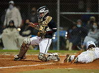 Riverview Rams catcher Kyle Upman (4) fields a throw as Bradley Ramsden (3) slides home safely during a game against the Sarasota Sailors on February 19, 2021 at Rams Baseball Complex in Sarasota, Florida. (Mike Janes/Four Seam Images)