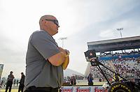 Apr 10, 2015; Las Vegas, NV, USA; Crew member Brandon Bernstein watches NHRA top fuel driver Shawn Langdon during qualifying for the Summitracing.com Nationals at The Strip at Las Vegas Motor Speedway. Mandatory Credit: Mark J. Rebilas-