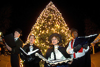 Christmas carolers sing holiday songs in old-fashioned style during the annual Christmas tree lighting event at Birkdale Village in Huntersville, NC. Birkdale Village combines the best of shopping, dining, apartments and entertainment venues within a 52-acre mixed-use development.