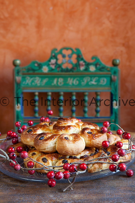 Detail of a traditional Swedish Christmas bread on a plate decorated with berries