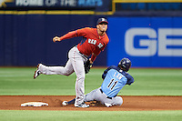 Boston Red Sox Yoan Moncada (22) covers the bag as Zacrey Law (11) slides in during an instructional league game against the Tampa Bay Rays on September 24, 2015 at Tropicana Field in St Petersburg, Florida.  (Mike Janes/Four Seam Images)