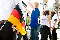 Fans of Germany gather outside of Zum Schneider, a German beer hall in New York City, after their team's game against Costa Rica on June 9, 2006. <br /> <br /> The World Cup, held every four years in different locales, is the world's pre-eminent sports tournament in the world's most popular sport, soccer (or football, as most of the world calls it).  Qualification for the World Cup is open to any country with a national team accredited by FIFA, world soccer's governing body. The first World Cup, organized by FIFA in response to the popularity of the first Olympic Games' soccer tournaments, was held in 1930 in Uruguay and was participated in by 13 nations.    <br /> <br /> As of 2010 there are 208 such teams.  The final field of the World Cup is narrowed down to 32 national teams in the three years preceding the tournament, with each region of the world allotted a specific number of spots.  <br /> <br /> The World Cup is the most widely regularly watched event in the world, with soccer teams being a source of national pride.  In most nations, the whole country is at a standstill when their team is playing in the tournament, everyone's eyes glued to their televisions or their ears to the radio, to see if their team will prevail.  While the United States in general is a conspicuous exception to the grip of World Cup fever there is one city that is a rather large exception to that rule.  In New York City, the most diverse city in a nation of immigrants, the melting pot that is America is on full display as fans of all nations gather in all possible venues to watch their teams and celebrate where they have come from.