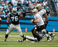 The Carolina Panthers played the New Orleans Saints for supremacy in the NFC South.  December 22, 2013 at Bank of America Stadium.  The Panthers scored the winning touchdown with 23 seconds left in the game to give them the opportunity to clinch the NFC South with a win next week.  New Orleans Saints quarterback Drew Brees (9) is sacked by Carolina Panthers cornerback Captain Munnerlyn (41).