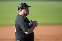 Kannapolis Intimidators manager Tommy Thompson (39) coaches third base during the game against the West Virginia Power at CMC-Northeast Stadium on April 21, 2015 in Kannapolis, North Carolina.  The Power defeated the Intimidators 5-3 in game one of a double-header.  (Brian Westerholt/Four Seam Images)