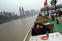CHINA. Sichuan Province. Chongqing. Mother and daughter on a tourist boat on The Yangtze River which is at its lowest level in 150 years as a result of a country-wide drought. Chongqing is a city of over 3,000,000 people, famed for being the capital of China between 1938 and 1946 during World War II. It is situated on the banks of the Yangtze river, China's longest river and the third longest in the world. Originating in Tibet, the river flows for 3,964 miles (6,380km) through central China into the East China Sea at Shanghai.  2008