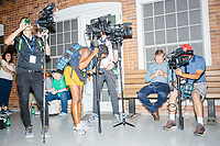 Media wait as South Bend mayor and Democratic presidential candidate Pete Buttigieg is interviewed by local Iowa media at the Iowa State Fair in Des Moines, Iowa, on Tues., Aug. 13, 2019.