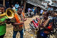 Afro-Colombian musicians perform on the street during the San Pacho festival in Quibdó, Colombia, 3 October 2019. Every year at the turn of September and October, the capital of the Pacific region of Chocó holds the celebrations in honor of Saint Francis of Assisi (locally named as San Pacho), recognized as Intangible Cultural Heritage by UNESCO. Each day carnival groups, wearing bright colorful costumes and representing each neighborhood, dance throughout the city, supported by brass bands playing live music. The festival culminates in a traditional boat ride on the Atrato River, followed by massive religious processions, which accent the pillars of Afro-Colombian's identity – the Catholic devotion grown from African roots.