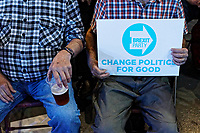 Pictured: Party supporters with a placard and a pint of beer in the auditorium. Tuesday 30 April 2019<br /> Re: Nigel Farage and Anne Widdecombe at the Brexit Party rally at The Neon in Clarence Place in Newport, south Wales, UK.