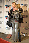 Actor James Woods shows off  his girlfriend & his jacket as they arrive on the red carpet.