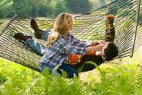 Couple relaxing in hammock