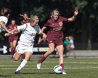 Virginia Tech midfielder Ashley Meier (15) dribbles as Boston College midfielder Kate McCarthy (21) pressures.Virginia Tech (maroon) defeated Boston College (white), 1-0, at Newton Soccer Field, on September 22, 2013.