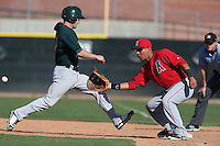 Efren Navarro #19 of the Los Angeles Angels takes a throw to first base during a Minor League Spring Training Game against the Oakland Athletics at the Los Angeles Angels Spring Training Complex on March 17, 2014 in Tempe, Arizona. (Larry Goren/Four Seam Images)