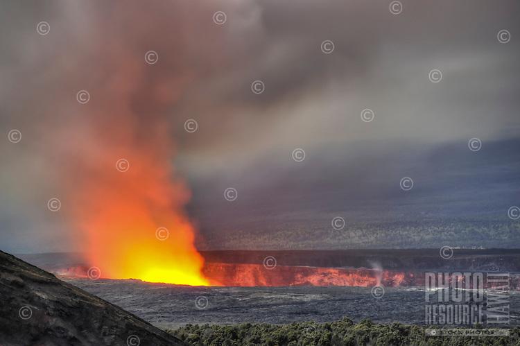Pele's lava glowing red in Halema'uma'u crater of Kilauea Volcano at Hawai'i Volcanoes National Park, Big Island of Hawai'i.