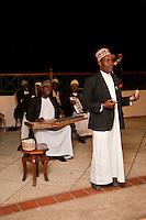 Zanzibar, Tanzania.  Taarab Musicians.  Culture Musical Club. Male Singer.