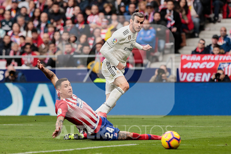 Atletico de Madrid's Jose Maria Gimenez and Real Madrid's Gareth Bale fight for the ball during La Liga match between Atletico de Madrid and Real Madrid at Wanda Metropolitano Stadium in Madrid, Spain. February 09, 2019. (ALTERPHOTOS/A. Perez Meca)