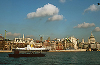 London:  Thameside Walk #8.  HMS President; Behind it, Spire of St. Bride's just visible over Hamilton House; St. Paul's to right.  Photo '90.