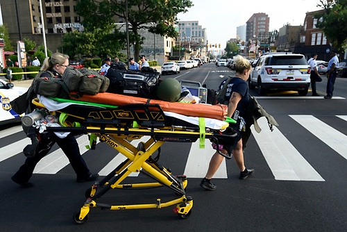 Paramedics roll a stretcher near the scene of a shooting incident in which several police were injured in Philadelphia, Pennsylvania, U.S. August 14, 2019. REUTERS/Bastiaan Slabbers
