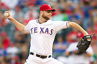 Texas Rangers pitcher Scott Feldman #39 delivers during the Major League Baseball game against the Baltimore Orioles on August 21st, 2012 at the Rangers Ballpark in Arlington, Texas. The Orioles defeated the Rangers 5-3. (Andrew Woolley/Four Seam Images).