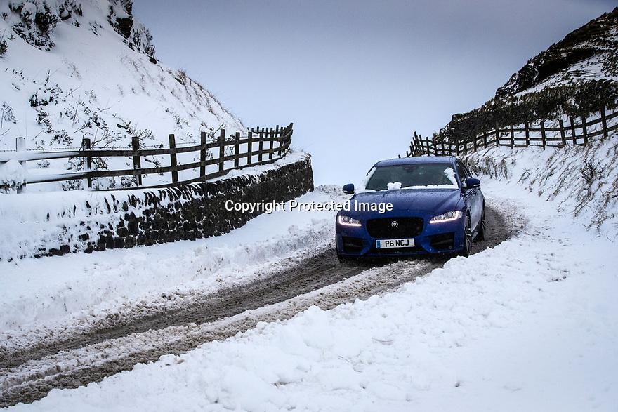 17/01/18<br /> <br /> A Jaguar makes its way over Mam Tor in the Derbyshire Peak District near Castleton..<br /> <br /> All Rights Reserved F Stop Press Ltd. +44 (0)1335 344240 +44 (0)7765 242650  www.fstoppress.com