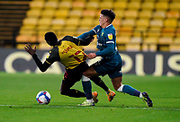 Max Aarons of Norwich City battles with Ken Sema of Watford during the Sky Bet Championship behind closed doors match played without supporters with the town in tier 4 of the government covid-19 restrictions, between Watford and Norwich City at Vicarage Road, Watford, England on 26 December 2020. Photo by Andy Rowland.