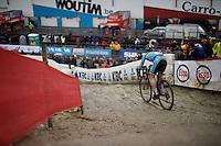Eli Iserbyt (BEL) descending the muddy slopes<br /> <br /> U23 men's race<br /> <br /> UCI 2016 cyclocross World Championships / Zolder, Belgium