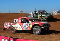 Apr 17, 2011; Surprise, AZ USA; LOORRS driver Jimmy Stephensen (33) leads Cameron Steele (16) during round 4 at Speedworld Off Road Park. Mandatory Credit: Mark J. Rebilas-