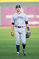Wilmington Blue Rocks third baseman Hunter Dozier (18) warms up in the outfield prior to the game against the Winston-Salem Dash at BB&T Ballpark on April 3, 2014 in Winston-Salem, North Carolina.  The Blue Rocks defeated the Dash 3-1.  (Brian Westerholt/Four Seam Images)