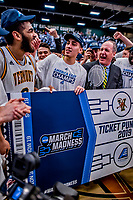 16 March 2019: University of Vermont Men's Basketball Team celebrates their victory over the UMBC Retrievers, in the America East Championship Game at Patrick Gymnasium in Burlington, Vermont. Shown here (left to right) are Forward Anthony Lamb, a Junior from Toronto, Ontario, Guard Robin Duncan, a Freshman from Evansville, IN, and Meghan and Robert Cioffi Men's Basketball Head Coach John Becker. The Catamounts defeated the Retrievers 66-49 to take the AE Championship for the 2018/2019 NCAA Men's Basketball season. Mandatory Credit: Ed Wolfstein Photo *** RAW (NEF) Image File Available ***