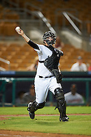 Glendale Desert Dogs Zack Collins (18), of the Chicago White Sox organization, throws to first during a game against the Salt River Rafters on October 19, 2016 at Camelback Ranch in Glendale, Arizona.  Salt River defeated Glendale 4-2.  (Mike Janes/Four Seam Images)