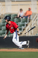 Grant Massey (16) of the Kannapolis Intimidators follows through on his swing against the Greenville Drive at Intimidators Stadium on June 7, 2016 in Kannapolis, North Carolina.  The Drive defeated the Intimidators 4-1 in game one of a double header.  (Brian Westerholt/Four Seam Images)