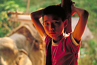 Portrait of a young Thai boy in a remote village near the Burma border. Thailand North of Chiang Mai near Burma.