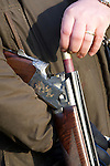 Pix: Shaun Flannery/sf-pictures.com..COPYRIGHT PICTURE>>SHAUN FLANNERY>01302-570814>>07778315553>>..19th December 2008...............Loversall 'game shoot' in Doncaster, South Yorkshire..A gun loads his 12 bore shotgun.