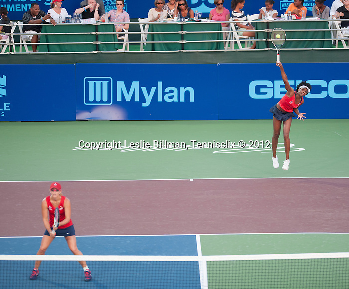 Venus Williams, serving, and Anastasia Rodionova play at the World Team Tennis match between the Washington Kastles and the Boston Lobsters on July 16, 2012 in Washington, DC.