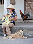 A mother passes a quiet moment with her child at home, Ninh Binh, Vietnam.