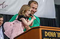 Kelly Maixner and his daughter tell his starting position number at the 2016 Iditarod musher position drawing banquet at the Dena'ina convention center in Anchorage, Alaska on Thursday March 3, 2016  <br /> <br /> © Jeff Schultz/SchultzPhoto.com ALL RIGHTS RESERVED<br /> DO NOT REPRODUCE WITHOUT PERMISSION